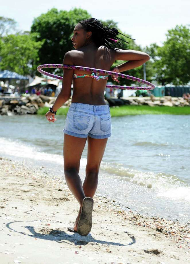 Olivia Pugh, 18, of Long Valley, NJ, dances along the shore of the Long Island Sound during the Gathering of the Vibes at Seaside Park in Bridgeport, Conn. Saturday, July 21, 2012. Photo: Autumn Driscoll / Connecticut Post freelance