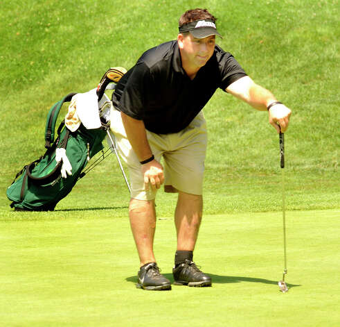 Howie Busse plays in the 22nd Annual Danbury Amateur golf championship at Richter Park Golf Course Saturday, July 21, 2012. Photo: Michael Duffy / The News-Times