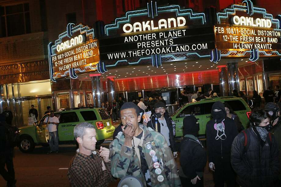 An Occupy Oakland protester addresses other demonstrators in front of The Fox Theater in Oakland, Calif., during a march against police brutality on Saturday, Feb. 11, 2012. Photo: Erik Verduzco, The Chronicle