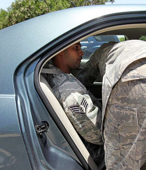 Air Force Sgt. Luis Walker is taken away in chains from  the 37th Training Wing Headquarters after sentencing on July 21, 2012. Photo: Tom Reel, San Antonio Express-News / ©2012 San Antono Express-News