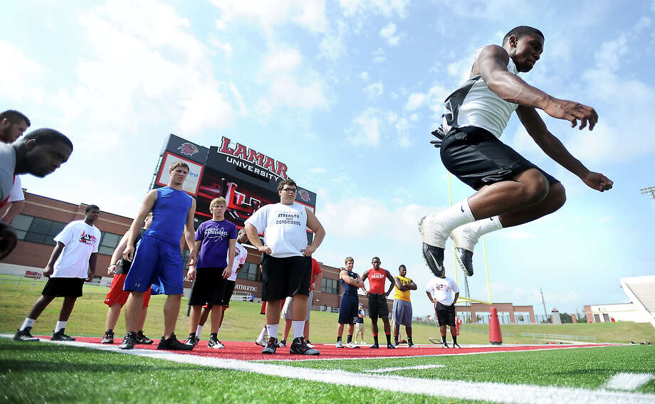 High School football players participate in trials during the Lamar Football Junior Senior camp at Provost Umphrey Stadium at Lamar University in Beaumont, Saturday, July 21, 2012. Tammy McKinley/The Enterprise Photo: TAMMY MCKINLEY
