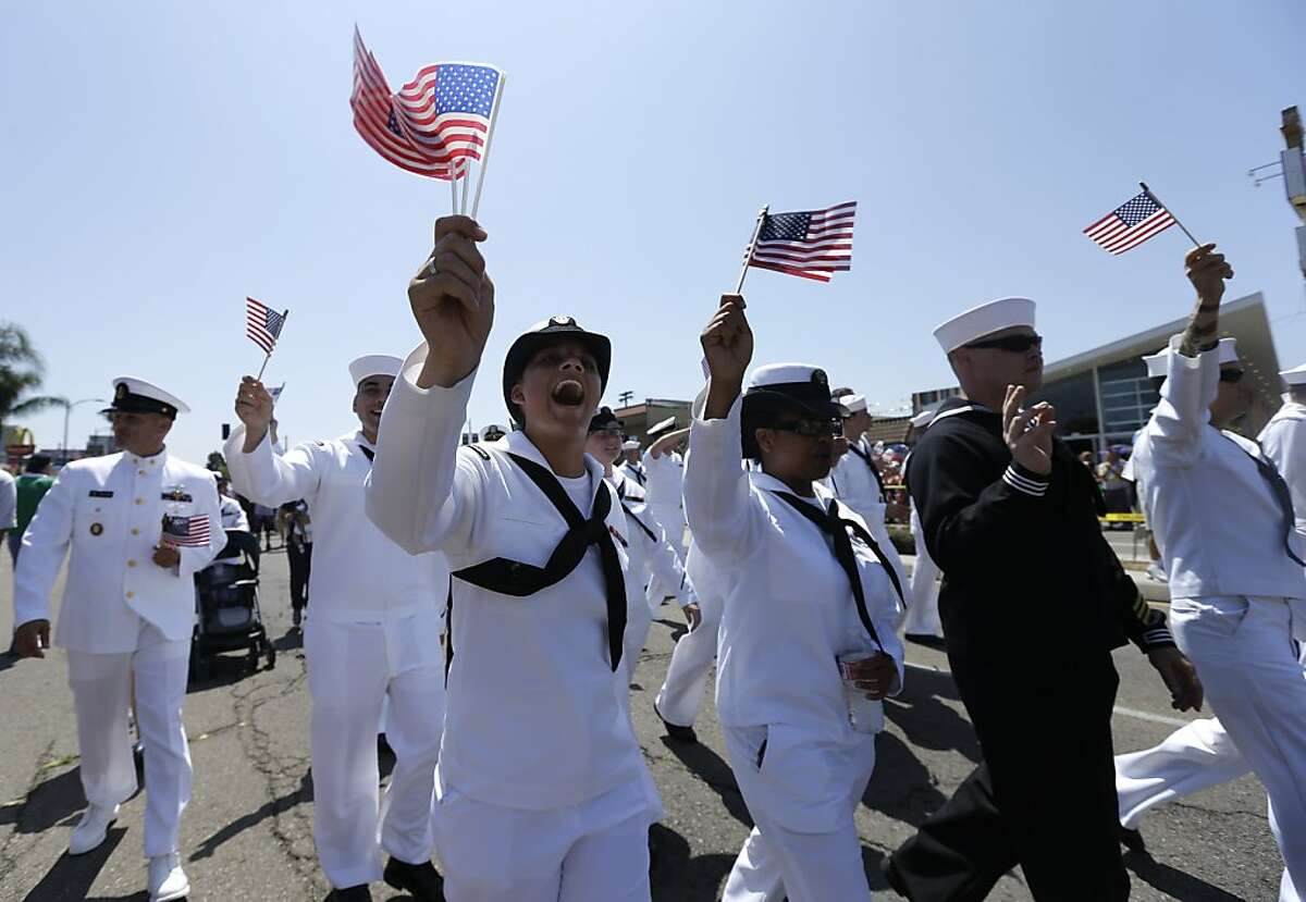 Sailors march in uniform during the gay pride parade Saturday, July 21, 2012, in San Diego. For the first time ever, U.S. service members marched in a gaypride event decked out in uniform Saturday, after a recent memorandum from the Defense Department to all military branches made an allowance for the San Diego parade - even though its policy generally bars troops from marching in uniform in parades. (AP Photo/Gregory Bull)