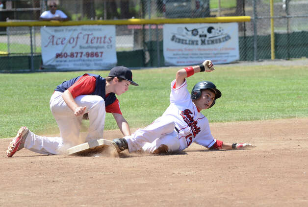 Fairfield American's Biago Paoletta (13) slides safely into second base under the tag of Annex's Sal Barnabei (4) during the Sectional Little League baseball game between Fairfield American and Annex at Southington Recreational Park in Plantsville on Saturday, July 21, 2012. Photo: Amy Mortensen / Connecticut Post Freelance