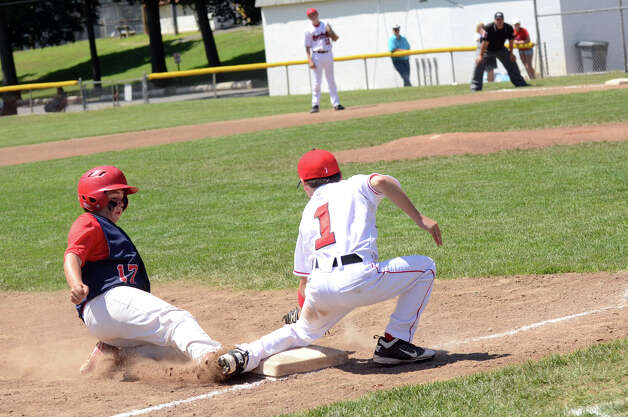 Annex's Zach Pellegrino (17) slides into third base under the tag of Fairfield American's Kevin Oricoli (1) during the Sectional Little League baseball game between Fairfield American and Annex at Southington Recreational Park in Plantsville on Saturday, July 21, 2012. Photo: Amy Mortensen / Connecticut Post Freelance