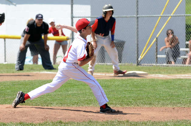 Fairfield American's Matty Clarkin (11) pitches during the Sectional Little League baseball game between Fairfield American and Annex at Southington Recreational Park in Plantsville on Saturday, July 21, 2012. Photo: Amy Mortensen / Connecticut Post Freelance