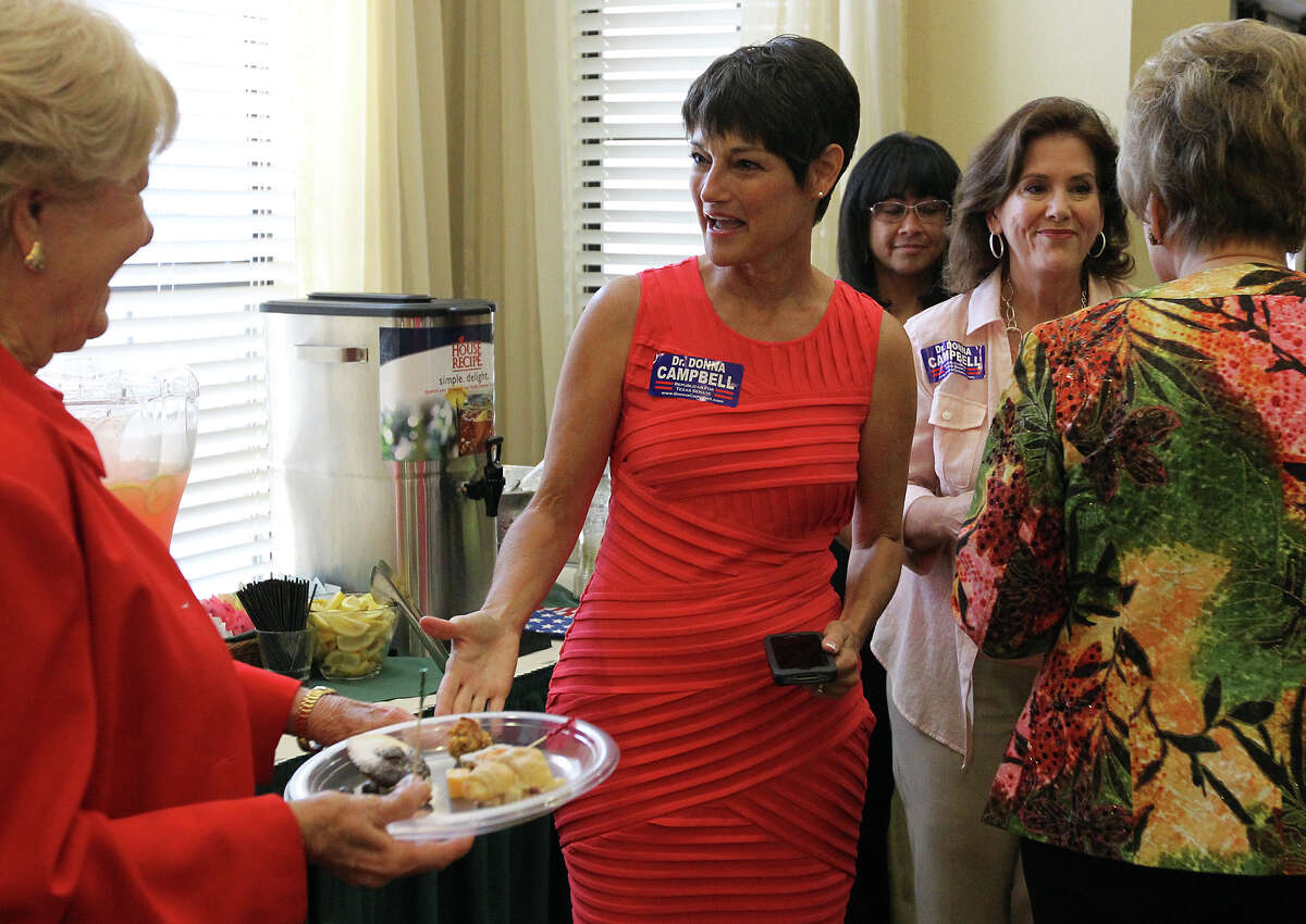 Dr. Donna Campbell (center) greets guests at the Alamo City Republican Women luncheon on Saturday, July 21, 2012. Campbell is in a run-off in the state senate race against incumbent Jeff Wentworth.