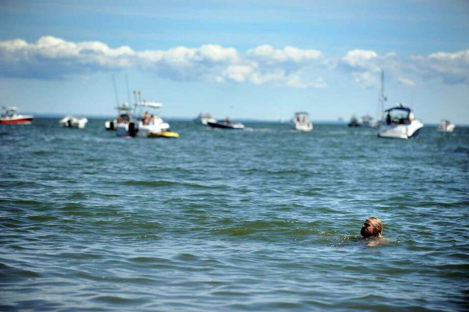 Daniel Murphy, of Brooklyn, NY, cools off in the Long Island Sound during the Gathering of the Vibes at Seaside Park in Bridgeport, Conn. Saturday, July 21, 2012. Photo: Autumn Driscoll / Connecticut Post freelance
