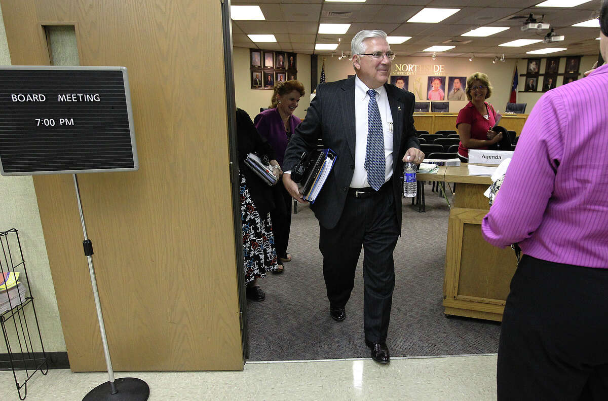 Outgoing superintendent Dr. John M. Folks (center) leaves a board meeting on his last day for Northside Independent School District on Tuesday, June 26, 2012. Folks has served as superintendent for NISD for nearly a decade before announcing his retirement back in December 2011.