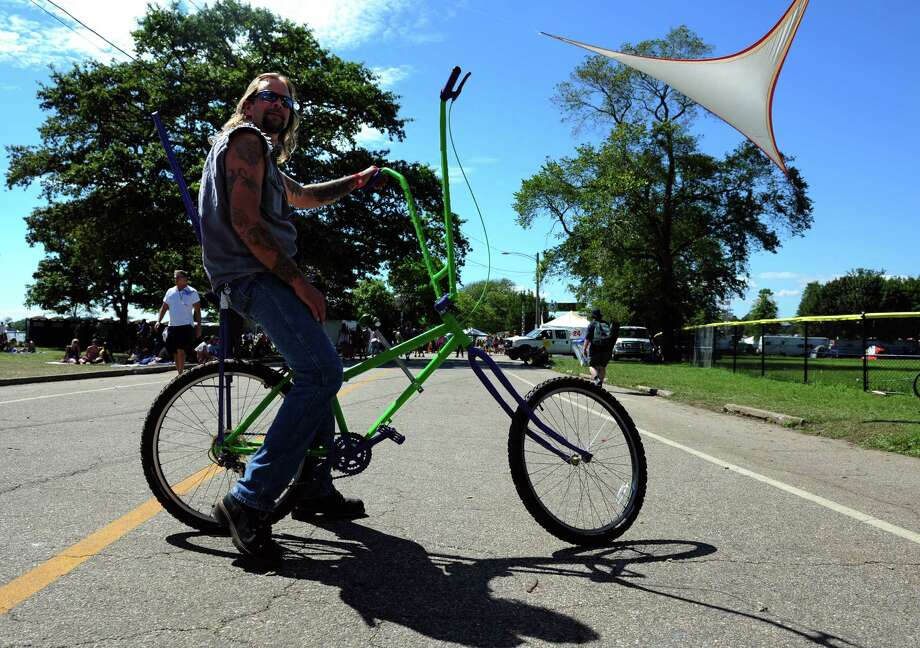 Tommy Karvinski, a bike builder from Stratford, sits on one of his creations during the Gathering of the Vibes at Seaside Park in Bridgeport, Conn. Saturday, July 21, 2012. Photo: Autumn Driscoll / Connecticut Post freelance