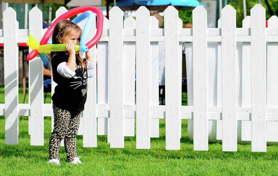 Abigail Tooker, 3, plays with a balloon outside a beer garden. Photo: LINDSEY WASSON / SEATTLEPI.COM