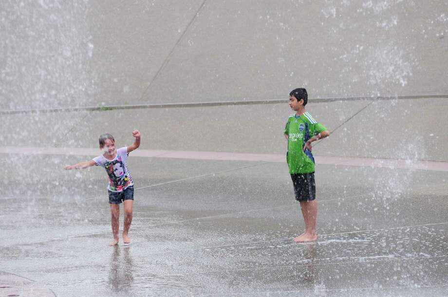 Two children play at the International Fountain. Photo: LINDSEY WASSON / SEATTLEPI.COM