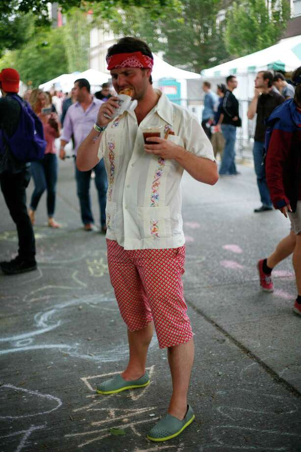 Layton Hayes sports green shoes while eating a burrito. Photo: Sofia Jaramillo / SEATTLEPI.COM