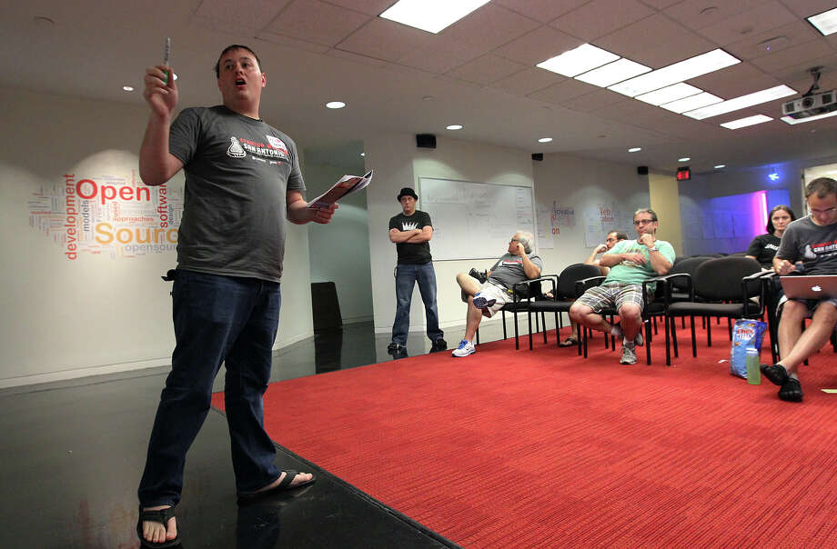 "Entrepreneur Chris Spence (left) pitches his business idea at the Kauffman Foundation's Startup Weekend hosted by Geekdom on Saturday, July 21, 2012. The weekend event gives entrepreneurs a chance to pitch their ideas or concepts and see if they are viable. The group with the best concepts will get picked on Sunday and receive prizes to help them get their project off the ground. ""It's about building connections and the ecosystem,"" said Nicholas Longo, Geekdom's director and a mentor for the event. ""This is the beginning of launching new ideas that may not go anywhere, or may. But what it is, is now they're all meeting each other and for other ideas they know who their team members can be."" Photo: Kin Man Hui, SAN ANTONIO EXPRESS-NEWS / ©2012 San Antonio Express-News"