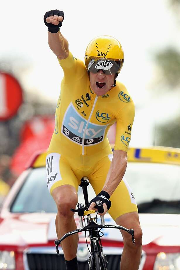 CHARTRES, FRANCE - JULY 21: Bradley Wiggins of Great Britain and SKY Procycling punches the air with delight as he celebrates winning the stage and securing the yellow jersey of the general classification during stage nineteen of the 2012 Tour de France, a 53.5km time trial from Bonneval to Chartres on July 21, 2012 in Chartres, France.  (Photo by Bryn Lennon/Getty Images) BESTPIX Photo: Bryn Lennon, Getty Images