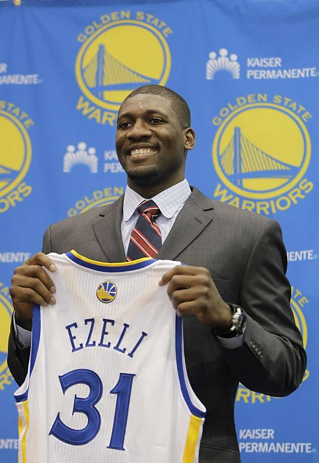 Golden State Warriors second draft pick Festus Ezeli, a center from Vanderbilt, holds up his new jersey during a news conference at Warriors headquarters in Oakland, Calif., Monday, July 2, 2012. (AP Photo/Paul Sakuma) Photo: Paul Sakuma, Associated Press