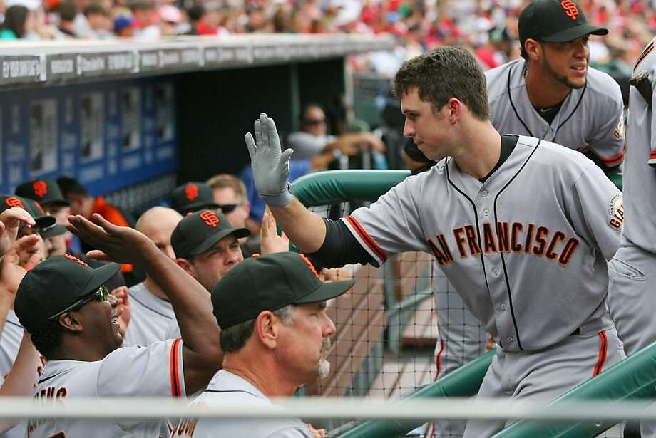PHILADELPHIA - JULY 21: Catcher Buster Posey #28 of the San Francisco Giants is greeted in the dugout by teammates after hitting a home run during a game against the Philadelphia Phillies at Citizens Bank Park on July 21, 2012 in Philadelphia, Pennsylvania. (Photo by Hunter Martin/Getty Images) Photo: Hunter Martin, Getty Images