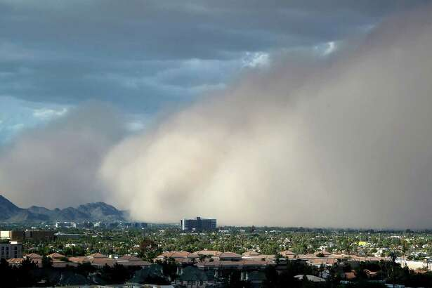 A large dust storm, or haboob, sweeps across downtown Phoenix, Saturday afternoon, July 21, 2012.  Dust storms are common across Arizona during the summer, and walls of dust more than a mile high can blanket an area in a matter of seconds, sometimes reducing visibility to zero..