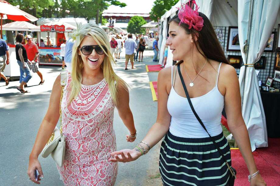Jillian Hannah, left, of Boston and Stephanie Roland of Rochester at Saratoga Race Course Saturday July 21, 2012.   (John Carl D'Annibale / Times Union) Photo: John Carl D'Annibale