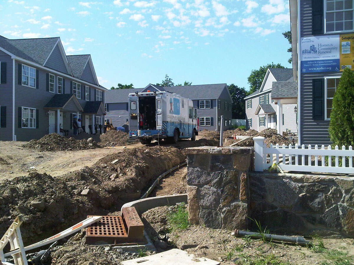 In this June 29, 2012 photo, the Cottage Landings affordable housing project is shown while under construction in Rye, N.Y. The development is part of a 750-unit requirement in the settlement of a 2009 lawsuit against Westchester County. The county is being criticized by the federal government over its implementation of the settlement. (AP Photo/Jim Fitzgerald)