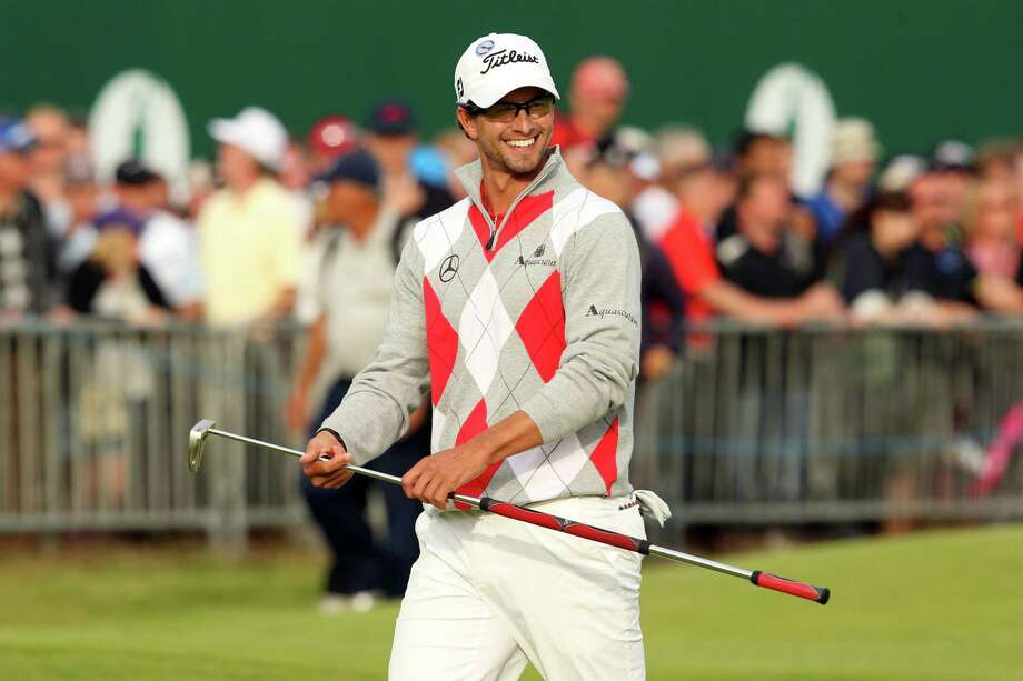 That Adam Scott reaches the 18th green with a smile is a good sign that the British Open is going his way. Up by four, he's on the cusp of his first major title. Photo: PETER MUHLY / AFP