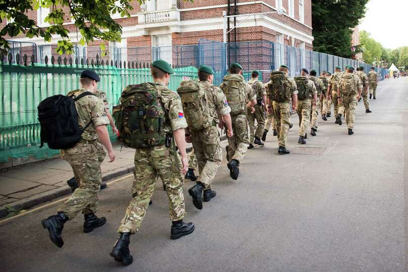 A group of soldiers heads toward the equestrian venue in Greenwich prior to the passing of the Olymp
