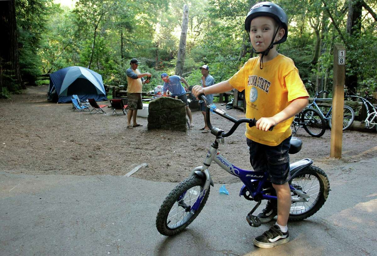Jake Ryan, 6 enjoys riding his bike around the Samuel P. Taylor State Park campgroundsns that the $22 million deficit they said was the reason why they had to close parks was completely false.
