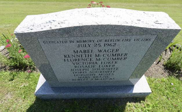 A head stone with the names of the deceased from the 1962 propane fire that devastated the village of Berlin sits above Route 22 in Berlin, N.Y. June 28, 2012.  (Skip Dickstein/Times Union) Photo: Skip Dickstein / 00018270A