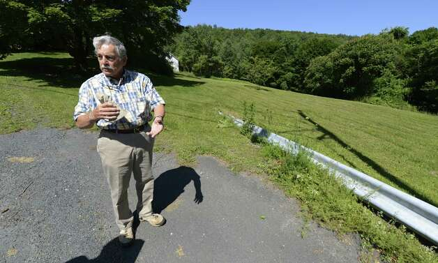 Dan  McCumber stands near the site of his parents home on Plank Road otherwise known as Rensselaer County Route 40 in Berlin, N.Y. June 28, 2012, which was the scene of the propane tank fire that killed 11 including his parents in Berlin, N.Y. in 1962.   (Skip Dickstein/Times Union) Photo: Skip Dickstein / 00018270A