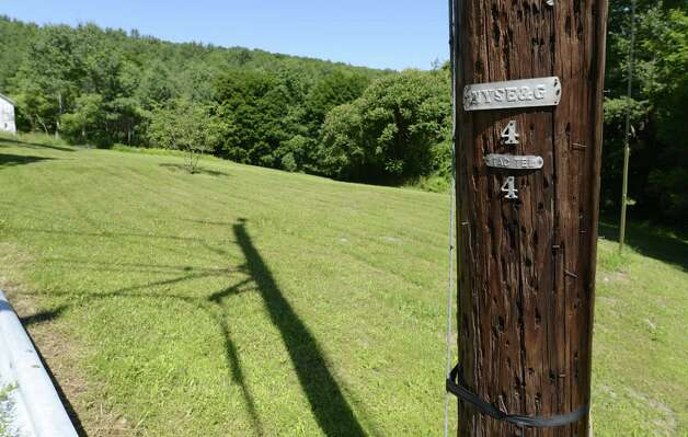 The utility pole on Plank Road otherwise known as Rensselaer County Route 40 in Berlin, N.Y. June 28, 2012, which was the scene of the propane tank fire that killed 11 in Berlin, N.Y. in 1962.   (Skip Dickstein/Times Union) Photo: Skip Dickstein / 00018270A