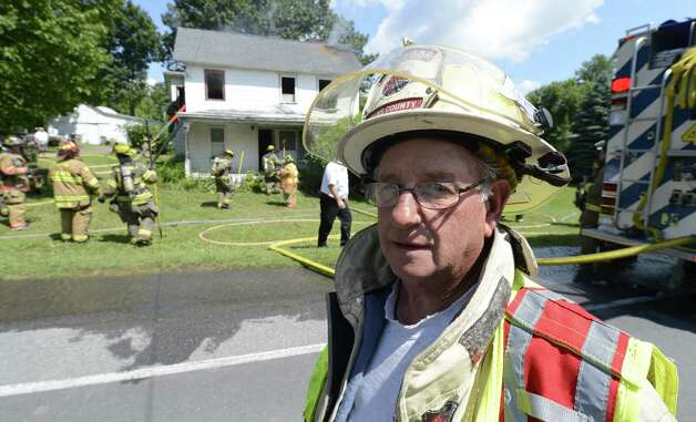Rensselaer County Fire Coordinator Ivan Wager is the only firefighter living that responded to the 1962 propane fire that devastated the village of Berlin sits above Route 22 in Berlin, N.Y. June 28, 2012.  (Skip Dickstein/Times Union) Photo: Skip Dickstein / 00018270A