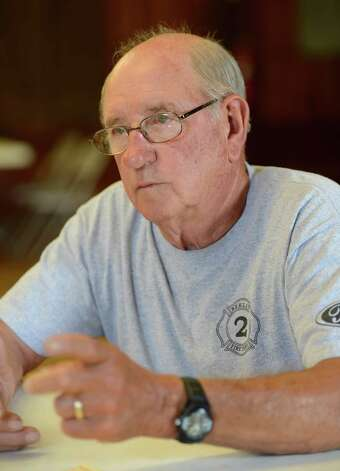 Rensselaer County Fire Coordinator Ivan Wager is the only firefighter living that responded to the 1962 propane fire that devastated the village of Berlin sits above Route 22 in Berlin, N.Y. June 28, 2012.  (Skip Dickstein/Times Union) Photo: Skip Dickstein / 00018360A