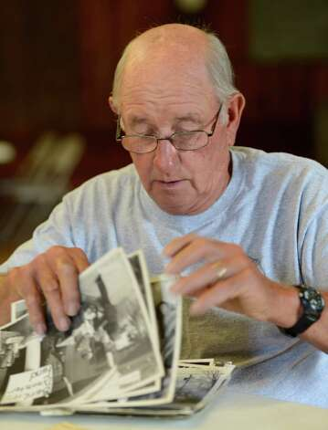 Rensselaer County Fire Coordinator Ivan Wager shuffles through historical images of Berlin explosion and is the only firefighter living that responded to the 1962 propane fire that devastated the village of Berlin sits above Route 22 in Berlin, N.Y. June 28, 2012.  (Skip Dickstein/Times Union) Photo: Skip Dickstein / 00018360A