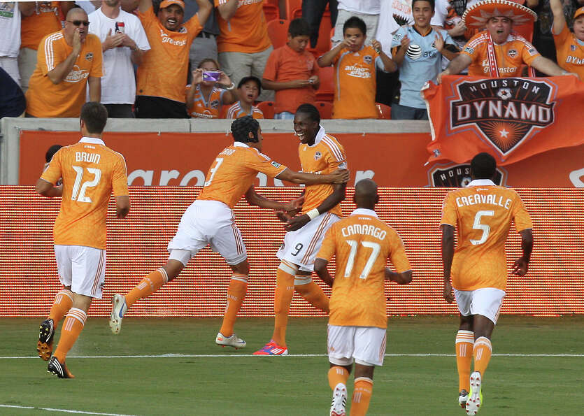 Dynamo forward Macoumba Kandji is congratulated by teammates after scoring a goal against the Montre
