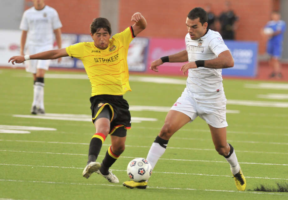 The Scorpions' Pablo Campos, dribbling past Fort Lauderdale's Emilio Orozco, scored his NASL-leading 11th goal late as San Antonio held off the Strikers 1-0 on Saturday, July 21, 2012, at Heroes Stadium. Photo: ROBIN JERSTAD, For The Express-News