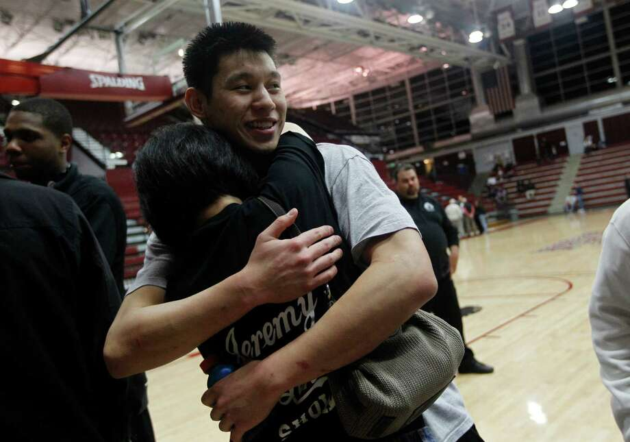 Family has always been important to Jeremy Lin, who celebrated a win while he was at Harvard with his mother, Shirley. Photo: Nhat V. Meyer / sjmn