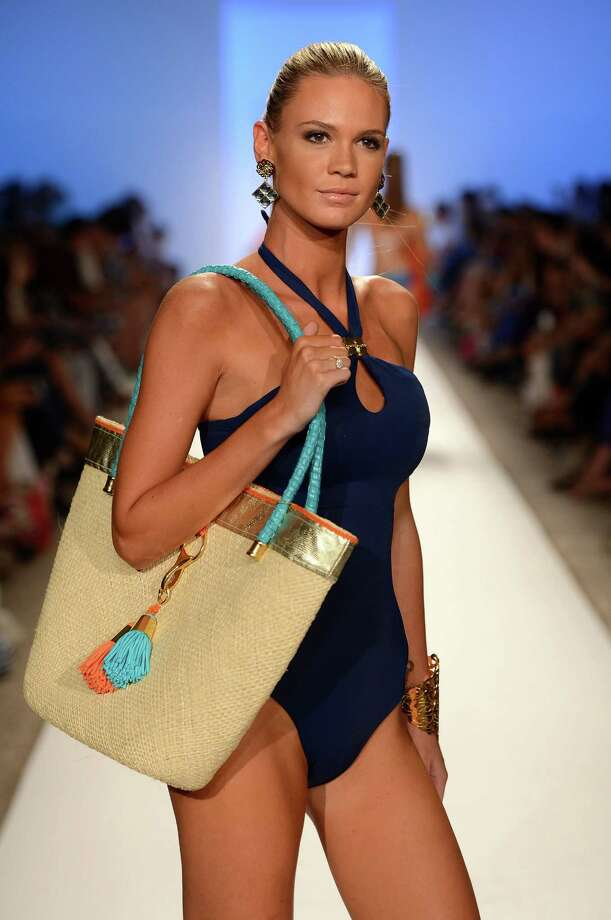 A model walks the runway at the Caffe Swimwear show. Photo: Frazer Harrison, Getty Images For Mercedes-Benz Fashion Week Swim 2013 / 2012 Getty Images