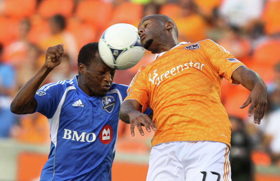 Houston Dynamo midfielder Luiz Camargo, right, heads the ball against Montreal Impact midfielder Sanna Nyassi (11) during the first half of an MLS soccer game Saturday, July 21, 2012, in Houston. (AP Photo/Houston Chronicle, J. Patric Schneider) MANDATORY CREDIT Photo: J. Patric Schneider, Associated Press / Houston Chronicle