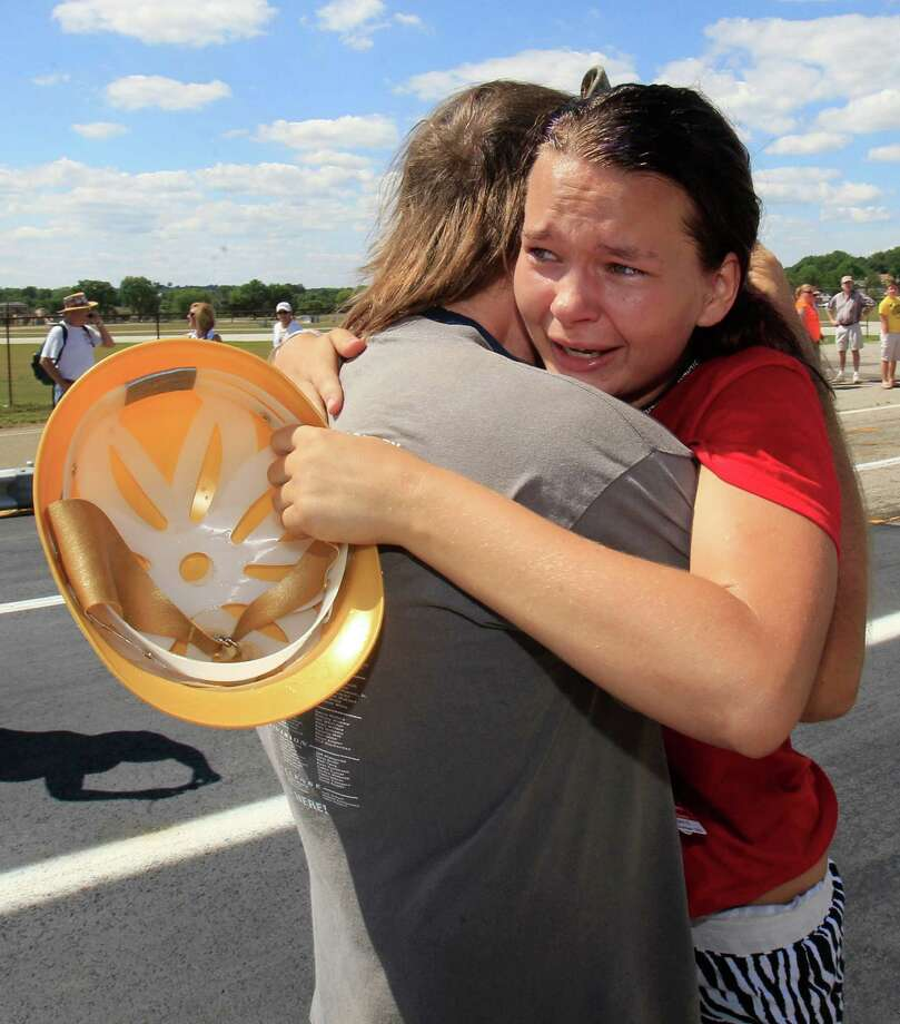 Kallie Myers, from St. Clairsville, Ohio, hugs her dad, Matt, after winning the Super Stock title race Saturday at the 75th All-American Soap Box Derby. Photo: Tony Dejak / AP