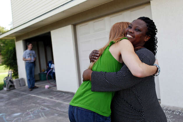 Leonia Espe, right, embraces Katy Hagerup, at the home of Scott and Nancy Hagerup in Seguin on Saturday, July 21, 2012. Espe and her children are living with Nancy and Scott Hagerup since being evicted from their San Antonio apartment Tuesday. Photo: Lisa Krantz, San Antonio Express-News / San Antonio Express-News