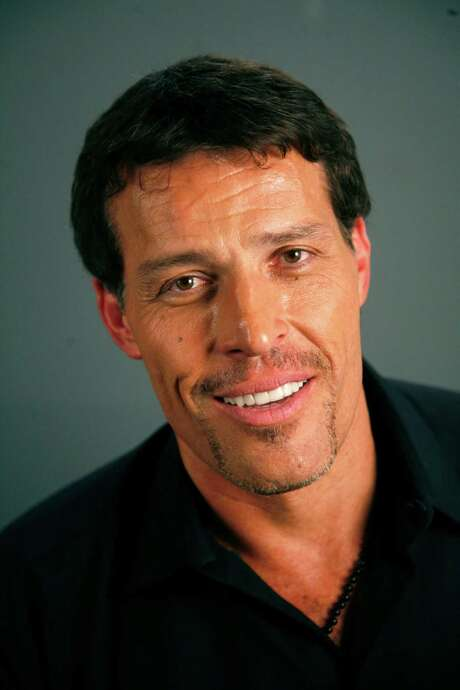 FILE - Tony Robbins poses for a portrait Monday, July 26, 2010 in New York. Fire officials in California say at least 21 people were treated for burns after attendees of an event for motivational speaker Tony Robbins tried to walk on hot coals. (AP Photo/Jeff Christensen, File) Photo: Jeff Christensen / AP