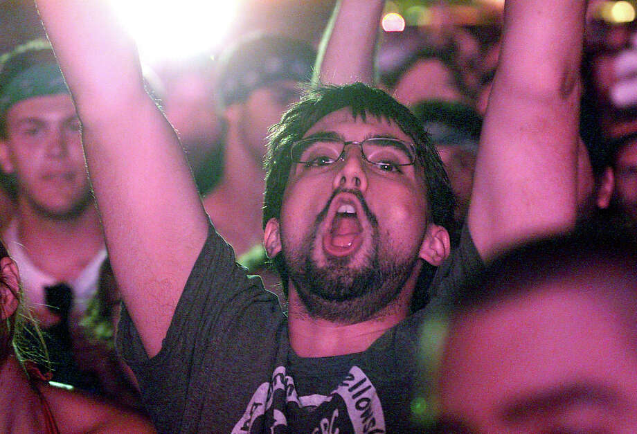A Primus fan cheers as the band comes onstage at the Gathering of the Vibes concert at Seaside Park in Bridgeport, Conn. on Saturday July 21, 2012. Photo: Christian Abraham / Connecticut Post freelance