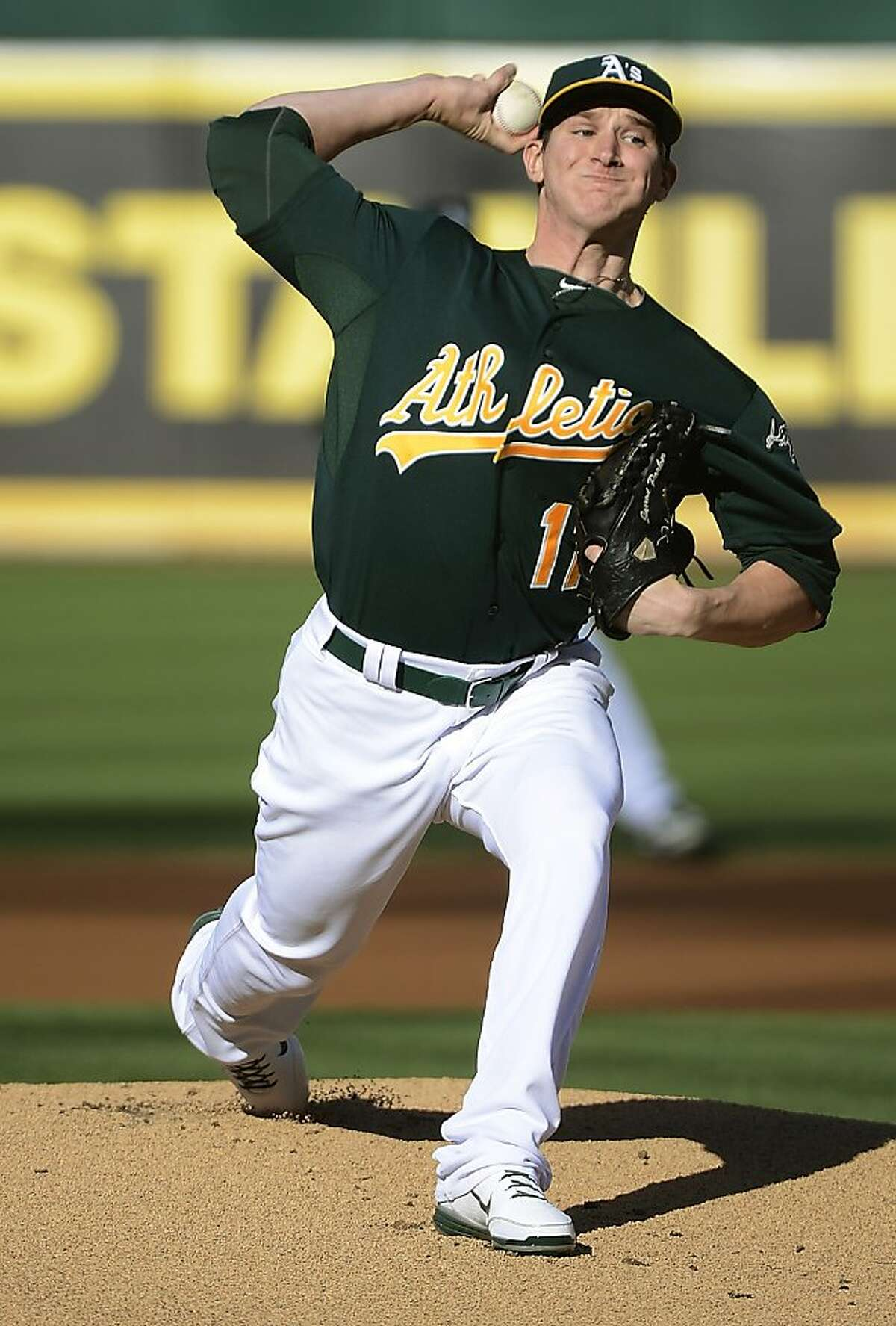 OAKLAND, CA - JULY 21: Jarrod Parker #11 of the Oakland Athletics pitches against the New York Yankees at O.co Coliseum on July 21, 2012 in Oakland, California. (Photo by Thearon W. Henderson/Getty Images)