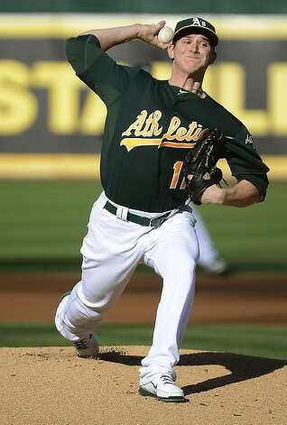 OAKLAND, CA - JULY 21:  Jarrod Parker #11 of the Oakland Athletics pitches against the New York Yankees at O.co Coliseum on July 21, 2012 in Oakland, California.  (Photo by Thearon W. Henderson/Getty Images) Photo: Thearon W. Henderson, Getty Images