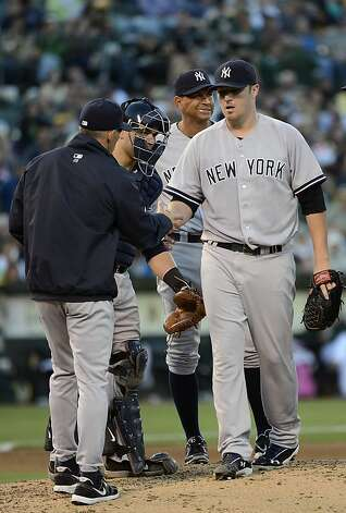 OAKLAND, CA - JULY 21: Manager Joe Girardi #28 takes the ball from pitcher Phil Hughes #65 taking him out of the game in the eighth inning against the Oakland Athletics at O.co Coliseum on July 21, 2012 in Oakland, California. The Athletics won the game 2-1. (Photo by Thearon W. Henderson/Getty Images) Photo: Thearon W. Henderson, Getty Images
