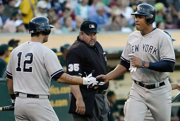 OAKLAND, CA - JULY 21:  Alex Rodriguez #13 of the New York Yankees is congratulated by Eric Chavez #12 after Rodriguez scored in the fourth inning against the Oakland Athletics at O.co Coliseum on July 21, 2012 in Oakland, California.  (Photo by Thearon W. Henderson/Getty Images) Photo: Thearon W. Henderson, Getty Images