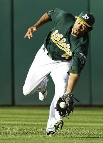 Oakland Athletics center fielder Coco Crisp catches a ball hit by New York Yankees' Curtis Granderson in the third inning of a baseball game on Saturday, July 21, 2012, in Oakland, Calif. (AP Photo/Ben Margot) Photo: Ben Margot, Associated Press