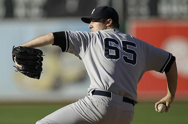 New York Yankees' Phil Hughes works against the Oakland Athletics in the first inning of a baseball game on Saturday, July 21, 2012, in Oakland, Calif. (AP Photo/Ben Margot) Photo: Ben Margot, Associated Press