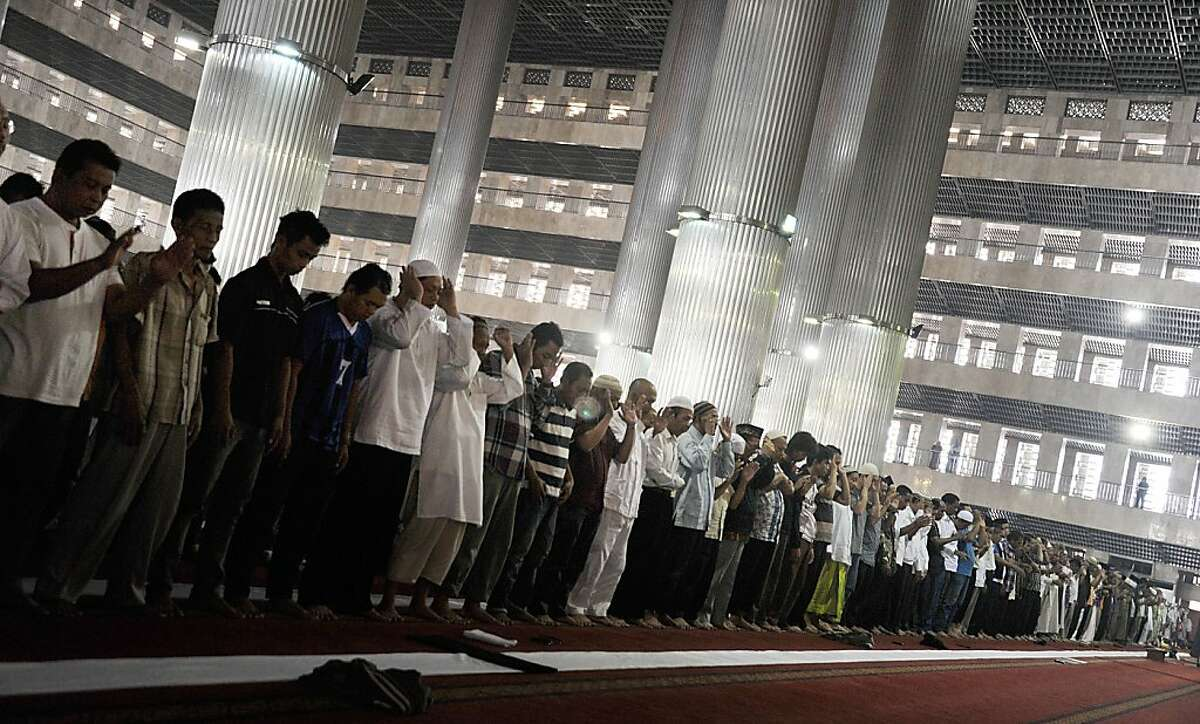 Indonesian Muslim attend a prayer during the first day of the fasting month of Ramadan in Jakarta on July 21, 2012. Muslims fasting in the month of Ramadan must abstain from food, drink and sex from dawn until sunset, when they break the fast with the meal known as Iftar. AFP PHOTO / Bay ISMOYOBAY ISMOYO/AFP/GettyImages