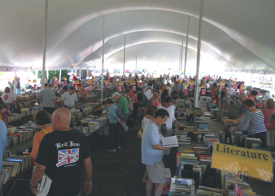 More than 80,000 books were offered at the 20th annual Summer Book Sale of the Westport Public Library, which opened Saturday on Jesup Green and the library's McManus Room. Photo: Mike Lauterborn / Westport News contributed