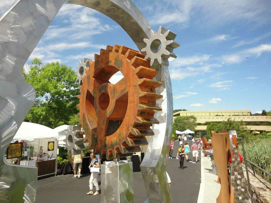 Sculptures by Dale Rogers were hard to miss at the Westport Fine Arts festival. They towered over the crowd at the festival dowentown venue along the Saugatuck River. Some are kinetic and their movable parts were repositioned by the wind. Photo: Meg Barone / Westport News freelance